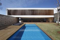 SN House was designed by Studio Guilherme Torres. The residence is located in Londrina, Brazil
