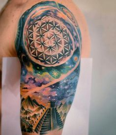 Aztec themed colored spacehalf sleeve tattoo - Tattooimages.biz