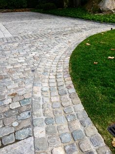 Reclaimed Belgian Porphyry cobblestone cubes create this useful and elegant swale.