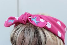 Unicorn & Polka Dot Pinup Bandana by Sins 'n Needles - Tame your tresses with this lovely pink and white polka dot pinup bandana! These great bandanas feature a bright blue unicorn embroidered on opposite corners so when you tie it they are visible. Perfect for protecting your hairstyle from the weather!