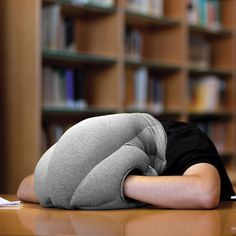 Right when I thought it couldn't get funnier!!!!!  Little pockets for his hands….. The Power Nap Head Pillow - Hammacher Schlemmer