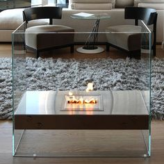 "EcoSmart Igloo Ventless Glass Fireplace - Who says ""fireplace"" has to equal ""rustic""? Metal Fireplace, Freestanding Fireplace, Fireplace Design, Fireplace Ideas, Verre Design, Glass Design, Interior Exterior, Interior Design, Best Electric Fireplace"