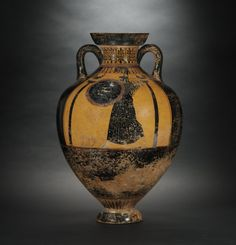 Black-figure Panathenaic amphora with Athena Promachos and athletes in race Creator: unknown Date: about 525-500 BC Location: Athens, Greece | On one side Athena Promachus is flanked by two columns surmounted by cocks. The other side depicts four athletes in a foot race.