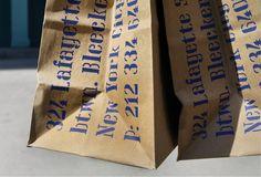 The restaurant's address set in Lisbon on takeaway bags.