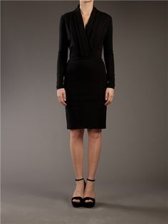DESCRIPTION  Black cotton blend dress from Stella McCartney featuring long sleeves, a deep v-neck with structured pleated panels and a fitted waist.  $910.00$455.00  (50% off)