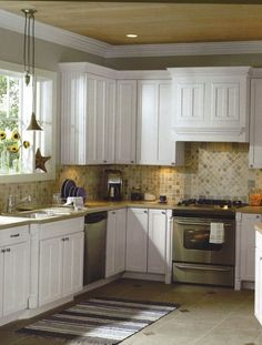 Tile Backsplash With White Cabinets kitchen:white cabinets, beige countertop, grey/green paint, white