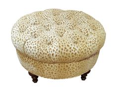 Round print fabric cheetah tufted ottoman with wood carved legs. It can be used as a coffee table or for seating.