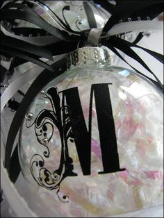 1. Scrapbooking Rub-Ons  2. Shredded basket fill  3. Glass ornaments  4. Ribbon- 3 spool    5. Self-adhesive 'dots'    How to -  1. Remove cap from ornament and fill with basket-fill. Replace cap  2. apply Rub-ons and self-adhesive dots  3. String 4 or 5 lengths of ribbon threw the ornament cap and tie in a bow.