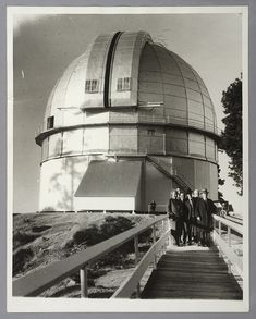 Left to right: Albert Einstein, Edwin Hubble, Walther Mayer, Walter S. Adams, Arthur S. King, and William W. Campbell pose in front of the 100-inch telescope dome at Mount Wilson Observatory. Jan. 29, 1931. The Huntington Library, Art Collections, and Botanical Gardens.
