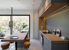 To make the most of the Ein Gedi Street apartment's 55 square metres of space, the pair knocked through existing walls and used wood panels to divide the apartment into rooms.