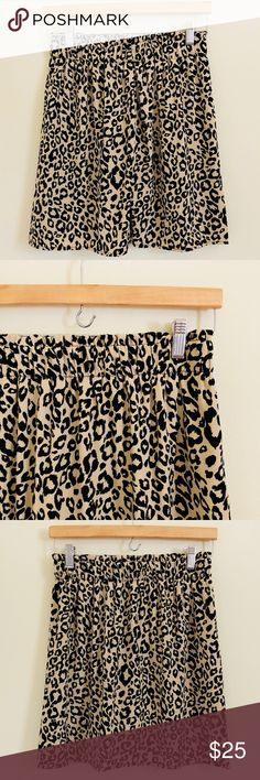 Miami for Francesca's Skirt Light weight and fully lined, leopard print skirt with gathered elastic waist, a loose but straight design. Can be dressed up or down depending on accessories and top. No rips, stains or pulls. Measurements are 13 inches across the waist when contracted, and 17 inches from waist to hem. ATC016 Francesca's Collections Skirts Midi