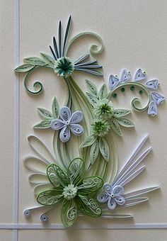 Quilling white and green flowers