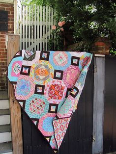 Double snowball quilt with brown blender sashing, mostly Kaffe Fassett Collective and Sis Boom fabrics