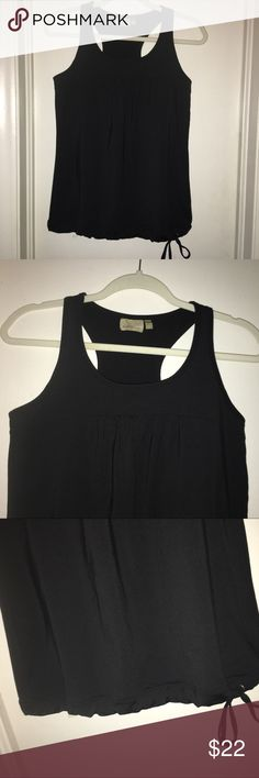 Athleta Top- Drawstring Bottom Excellent used condition workout tank. No stains or holes. 88% polyester 12% Lycra spandex. Smoke free/pet friendly home.   Approximate Measurements   Length: 23 in  Bust: 16 in Athleta Tops Tank Tops