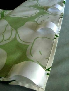 Make curtains out of flat sheet by glueing ribbon loops on the back
