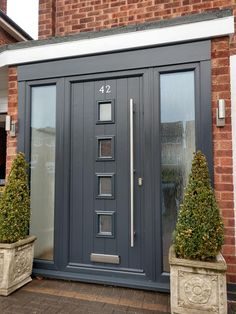 This stylish grey front door not only looks great, its secure, energy efficient and has a 10 year guarantee. There are hundreds of options to choose from, design your door online. Modern Exterior Doors, Exterior Doors With Glass, Exterior Front Doors, Modern Front Porches, Modern Front Door, Grey Front Doors, Home Door Design, House Gate Design, House Front Porch
