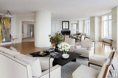 LIVING ROOM A pair of massive structural columns (one is shown) anchor the living room. Victoria Hagan Designs a Luminous Milwaukee Residence Architectural Digest, Condo Living, Living Spaces, Living Rooms, Small Living, Living Room Inspiration, Interior Design Inspiration, Victoria Hagan, High Rise Apartments