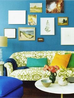 From Domino mag...love the wall color, really love all the colors...not sold on the couch.