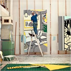 photography of artist Roy Lichtenstein painting