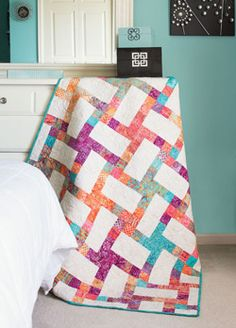 This batik quilt can be a little deceiving. It may look like it's made with rectangle quilt blocks, but they are actually square quilt blocks.