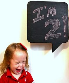 This speech-bubble chalkboard is for sale on Etsy for $20. Great photo prop.