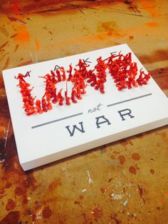 Make love not war painting with vinyl decal, and toy soldiers #love, #war, #toysoldiers #design #makelovenotwar