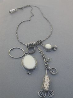 Necklace | Jamie Jo Fisher.   Oxidized sterling silver, vintage glass, a piece of coral