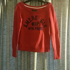 Red American Eagle crew neck Super cute sweatshirt, wore It once but it was too small. American Eagle Outfitters Tops Sweatshirts & Hoodies
