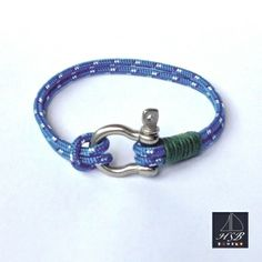 Blue paracord bracelet with green line and stainless steel shackle - 45 RON