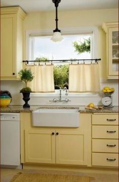 Farm sink, yellow cabinets, pendant light and add concrete counter tops
