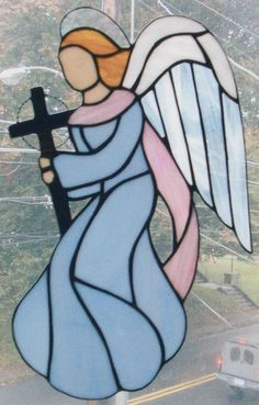 Stained Glass Angel holding Cross by StarLiteStainedGlass on Etsy, $65.00