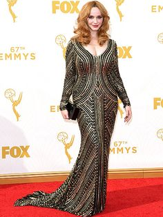 The Most Gorgeous Gowns on the Red Carpet at the 2015 Emmys | CHRISTINA HENDRICKS | Fresh off her front row stint at Naeem Khan, the Mad Men star wears the designer's striking, allover-embellished column and a Charlotte Olympia clutch (and if she's baking in the hot L.A. sun, she certainly doesn't show it).