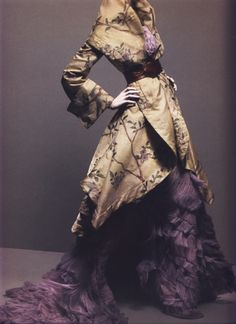 Alexander McQueen Autumn/Winter 2006-07Ensemble Widows of CullodenCoat of ivory silk embroidered with silk thread; dress of lilac silk tulle    Photographed by Sølve Sundsbø for Alexander McQueen: Savage Beauty