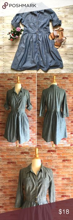 """Old Navy chambray shirt dress Add a belt or a summer scarf, this chambray shirt dress is a classic silhouette and can be accessorized many different ways. Button front. Button tab sleeves. Pockets! In excellent condition. Cotton. 36""""L. 18.6"""" bust, 15.5"""" waist both laying flat. Size 8. *Sandals pictured are also available in my closet, buy the look and save! Old Navy Dresses"""