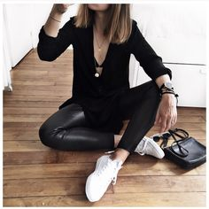 all about leather pants, low cut v neck tee, and pair of converse
