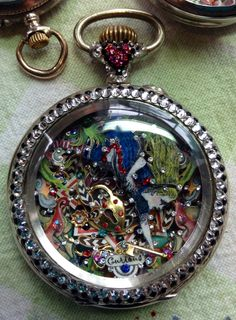 """Alice in Wonderland """"Down the Rabbit Hole"""" mixed media micro-mosaic inside antique men's pocket watch case, by Tracey Davis"""