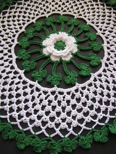 The Irish Blessings Crochet Doily combines a beautiful Irish Rose with rounds of lucky shamrocks and traditional Irish lace and picots. This is a fabulous crochet doily pattern that you can bring out every year.