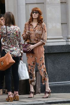 Florence Welch wore a Gucci Pre Fall oshibana printed crepe de chine blouse with degrade printed georgette gathered trousers, burgundy leather high heel sandals, tortoise shell sunglasses and burgundy top handle 'bamboo' bag whilst out shopping on Bond Street in London on September 4, 2012.