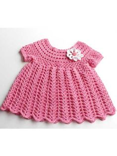 The scoop neckline slides over the head and the dress fits nicely with an empire waistline that falls into a gentle A-line skirt. The optional flower can be pinned on, or add a ribbon around the waist for a different look! Design is made using a sport-weight yarn and is written in sizes 12 mos–4T.