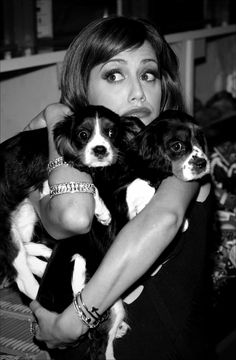 Brittany Murphy with pups. Seemed like a nice person. Died way too young. ÷^(