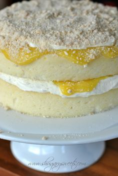 Homemade Lemon Cake with a layer of creamy lemon frosting and fresh lemon curd #cakerecipe #lemon @Shugary Sweets