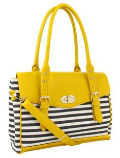 The ALDO Whittiker bag uses a fantastic color contrast to make a bold statement that pairs well with something fun.