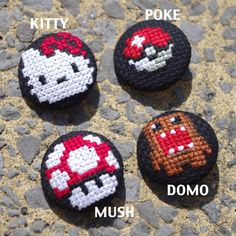 Handmade cross stitch buttons! Pop culture characters! Hello Kitty. Pokemon. Mario Mushroom. Domo. Set of 4 or individual buttons available!