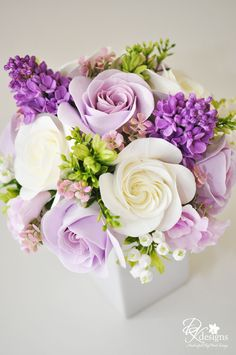 Lovely purple and ivory inspiration for centerpieces.  Striking use of light green accents.  Low arrangements help line of sight conversation.