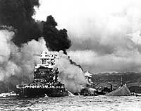 Pearl Harbor Attack, 7 December 1941    USS Maryland alongside the capsized USS Oklahoma.  USS West Virginia is burning in the background. Official U.S. Navy Photograph, National Archives collection.
