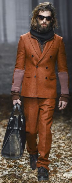 I heard today that Burnt Orange was in for spring. Hat the beard, Love the suit!