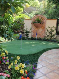 Creating a backyard putting green is much cheaper than going out for mini golf. Plus, you can pick up the putter anytime you want. Design by Scott Cohen