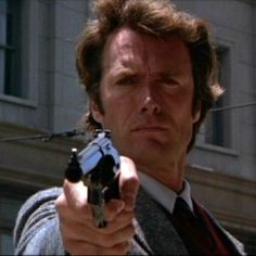 Clint Eastwood in Dirty Harry (1971) as Harry Callahan with Magnum