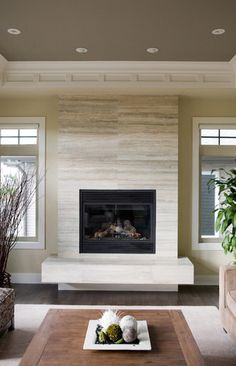 Limestone fireplace tile. Houzz.