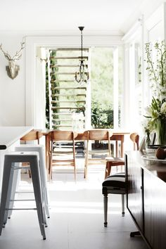 Wooden Chairs, Lot of Light, Flowers and Plants #interiors #home
